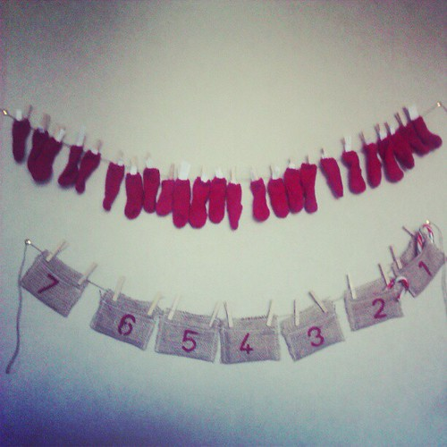 Our countdown wall, the advent activity calendar with my knitted mini socks and my beloved's birthday countdown.