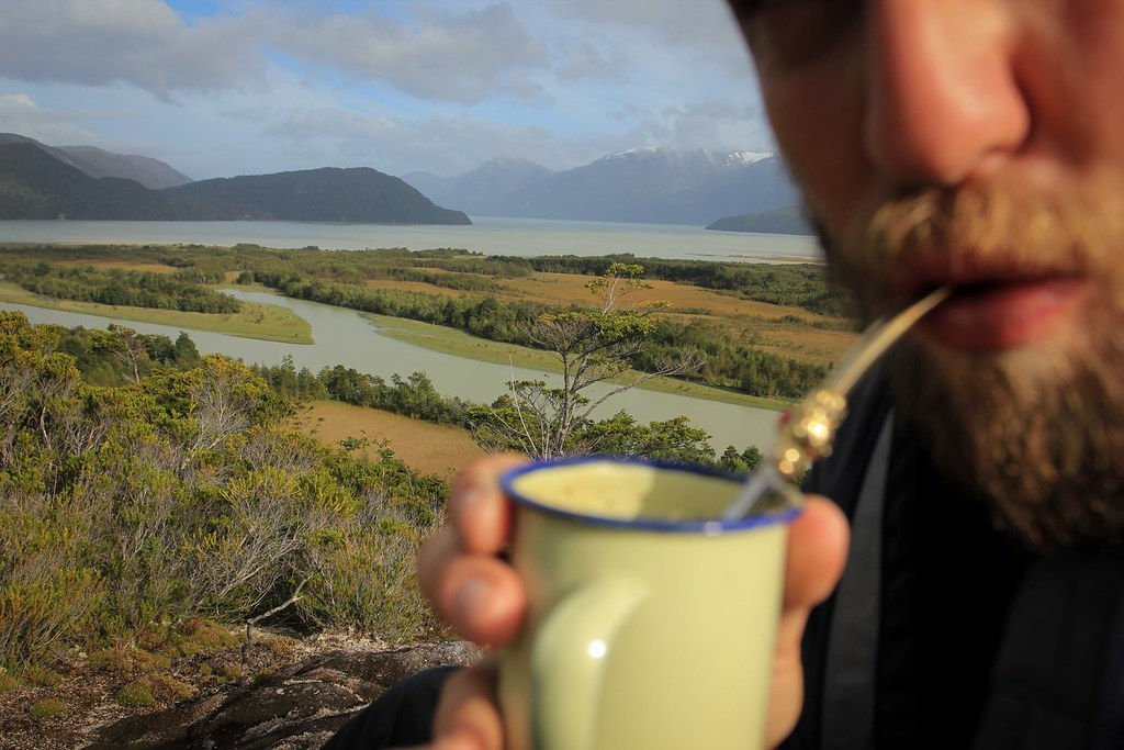 Sipping Mate at the Baker's mouth in the Pacific. Aysen, Chile.