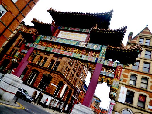 Imperial Arch Dominating the Skyline, China Town, Manchester by Angela Seager