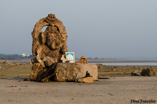 a ganesha idol on the bank of  lake gandipet