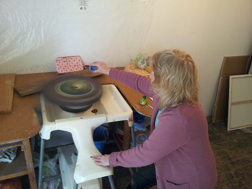 Karen making some spin art on a potters wheel. by phatcontroller