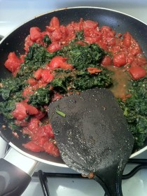 Tomatoes and spinach in skillet