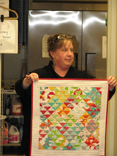 A mini by Sue. And she quilted it herself