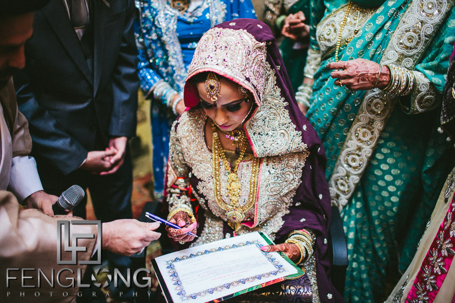 Signing the marriage contract for an Islamic wedding
