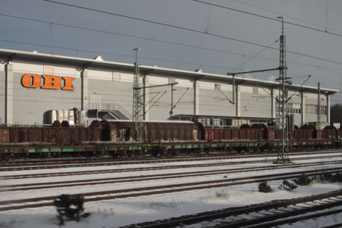 Stabled DB freight wagons beside an OBI hardware store at Nuremberg