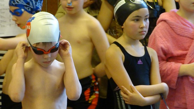 His first real swim meet