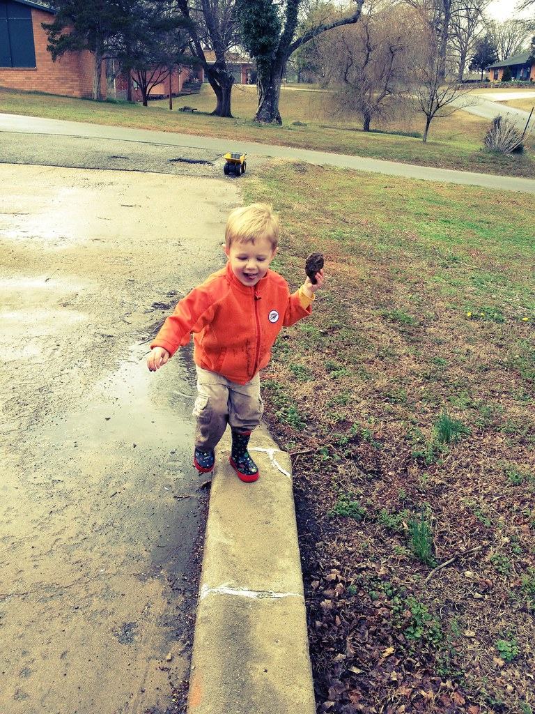 A boy and his puddles.