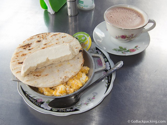 Arepa with eggs, cheese, and hot chocolate