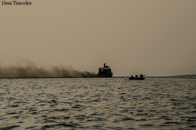 smoke coming out from motorboat polluting the air