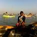 Fisherwoman on boat