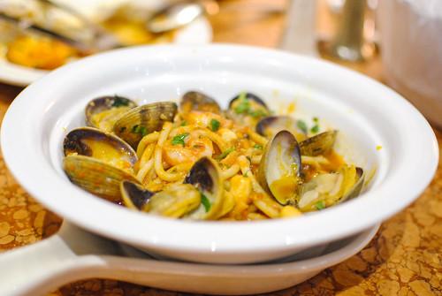 Bigoli ai Frutti di Mare thick spaghetti with seafood in a tomato base