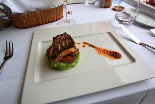 Grilled fish filet on leek scallion puree