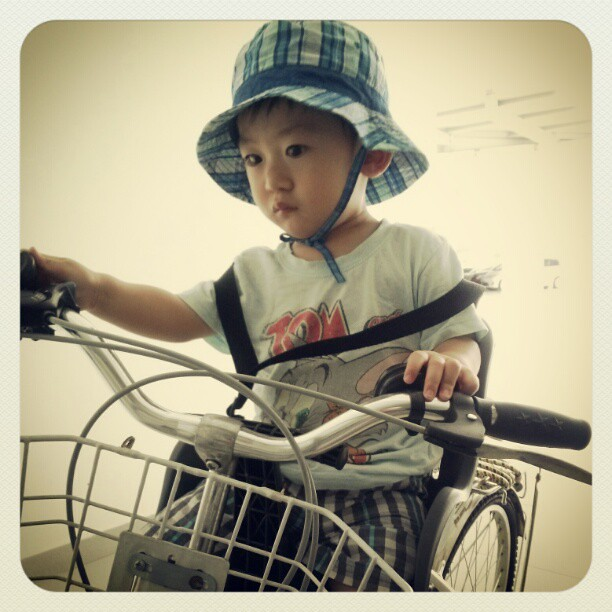 Asher riding on a bicycle with me