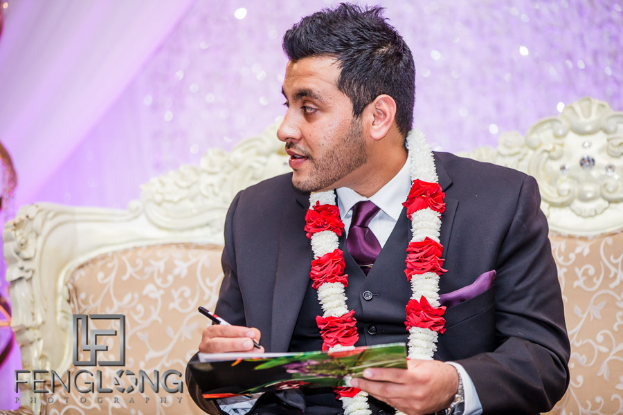 Groom signing wedding contract at Muslim wedding