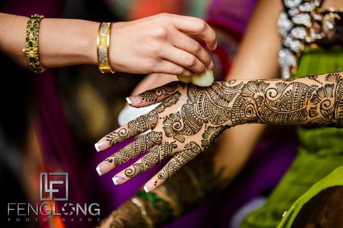 Bride's henna getting lemon juice applied