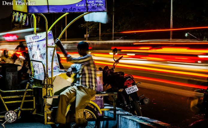 light streaks motorcycle slow shutter speed ice cream seller low light photography