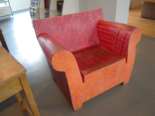 Decoupaged wooden chair in a paper shop, Manchester, UK