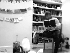 Reading from a book in a home library