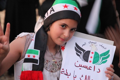 Young girl in the anti-regime camp at a demonstration outside the Syrian Embassy in Jordan by JessicaOmari