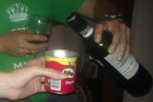 Pouring wine into a Pringles container