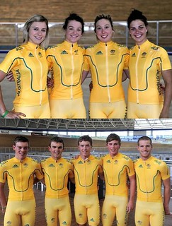 two cycling teams, male and female, in identical gear: short sleeved tight zip-up tops and knee length cycling shorts.