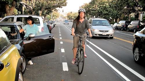 My Neighbor Heather Rides 14th St. Buffered Bike Lane