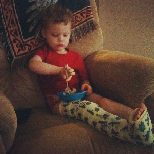 Don't you all eat your mash potatoes while rocking an awesome dinosaur cast.