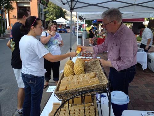 Mark provides honey samples for customers