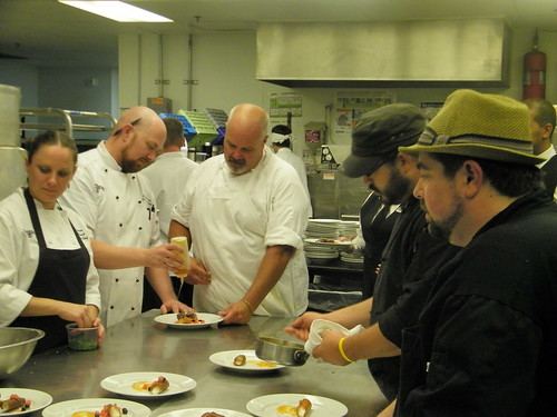 Chef Ref Laurence Willard assists teams