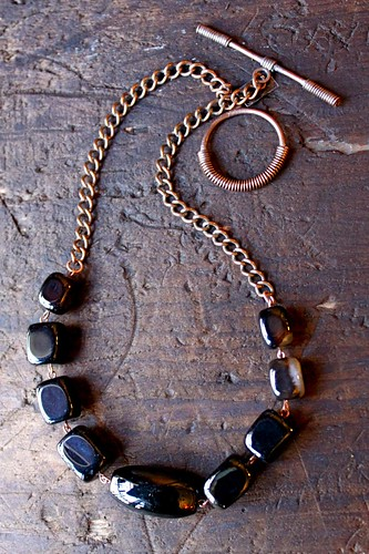black & white agate chunks on copper by denise carbonell