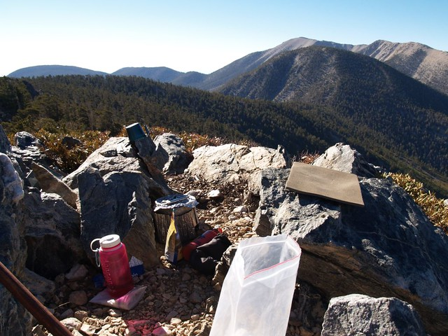 Cooking breakfast on the rocky summit of Alto Diablo Peak