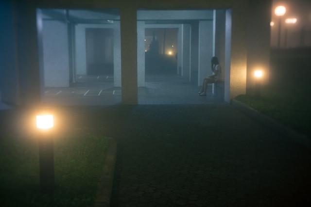A lone girl in the dark
