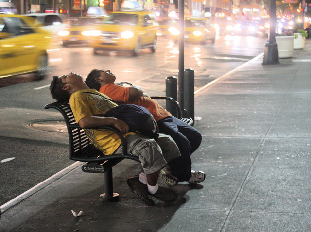 new york city fifth avenue men sleeping