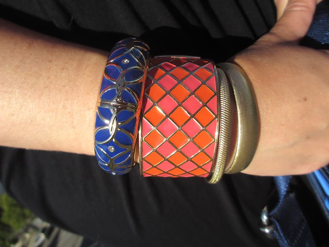 A mix of blue and pink (and orange) enamel and gold bracelets. (Photo by Pat Zimmerman.)