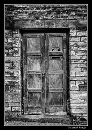 Monochrome Door by Dervish Images