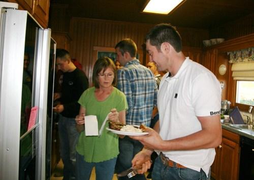 Julie helps James to a napkin