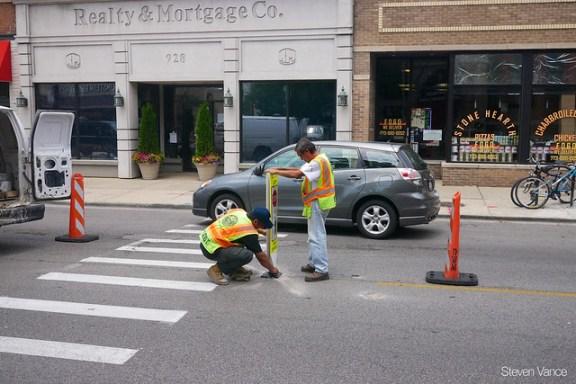 Stop for pedestrians in crosswalk sign installation