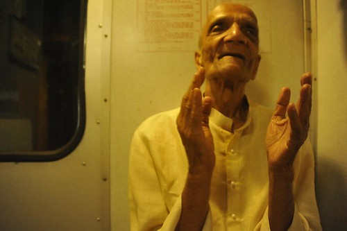 An eighty-six year young, renouncing the business empire, works for betterment of blind. On train, India