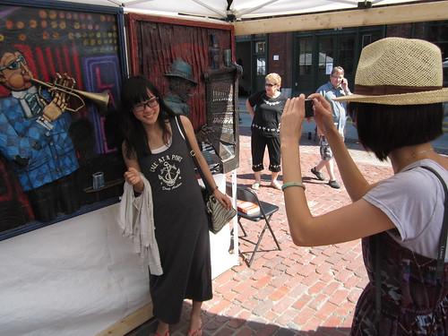 Korean Girls snapshots at Christian Aldo booth, fine arts painting