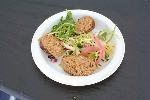 Cook's County spretzel with mustard dipping sauce; grilled sausage salad with pickled onion