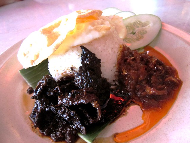 Nasi lemak with masak hitam