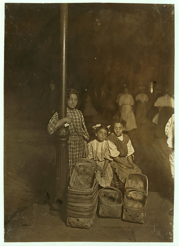 Marie Costa, Basket Seller, 605 Elm St., Sixth St. Market, Cincinnati. 9 P.M. Had been there since 10 A.M. Sister and friend help her.  (LOC)