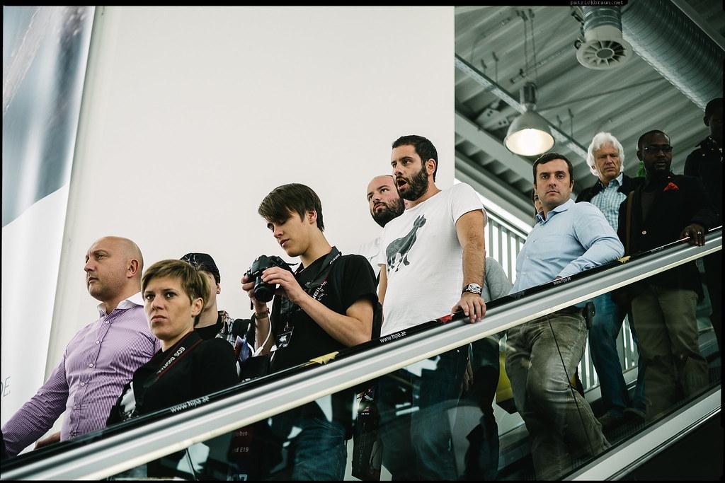 photographers on an escalator