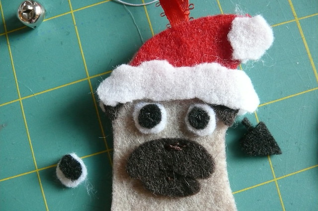 You can see the detail better here-- I like to stitch the muzzle with a few short stitches at the top to suggest a little nose.