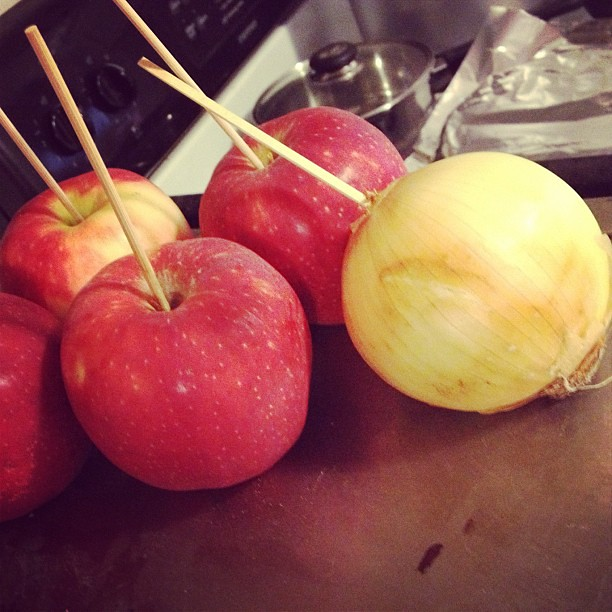 My brother, making caramel apples, is an evil genius.
