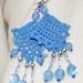 Crocheted earrings in blue