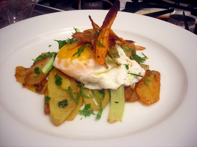 "Poached farm egg, pan-fried heirloom potatoes and cauliflower greens, with cumin carrot ""chips"""