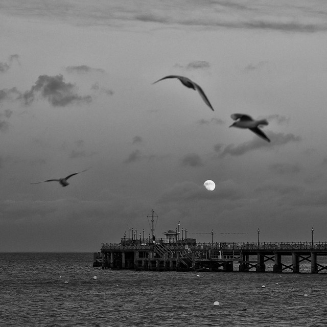 Full moon over Swanage Pier