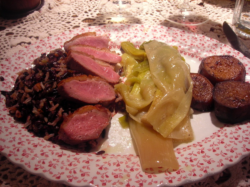 Sliced sautéed duck breast, jus; Butter-braised leeks, roasted Japanese sweet potato slices with merken, wild rice/black rice/lentil/basmati rice mix