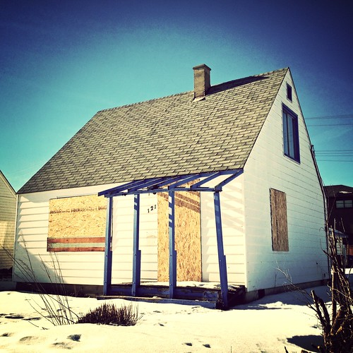 Tattered porch from abandoned and condemned home on 19 St. N.W. in Calgary
